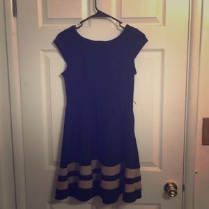 Black dress with two horizontal tan stripes